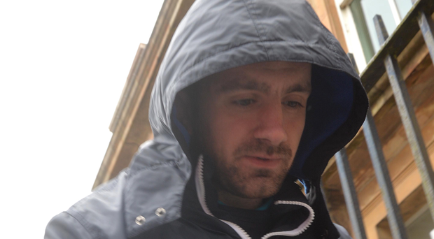 John McClements leaves court after being charged with the murder of Paul McCauley