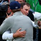 ST ANDREWS, SCOTLAND - JULY 20: Zach Johnson of the United States celebrates with Jordan Spieth of the United States after winning the 144th Open Championship at The Old Course during a 4-hole playoff on July 20, 2015 in St Andrews, Scotland. (Photo by Streeter Lecka/Getty Images)