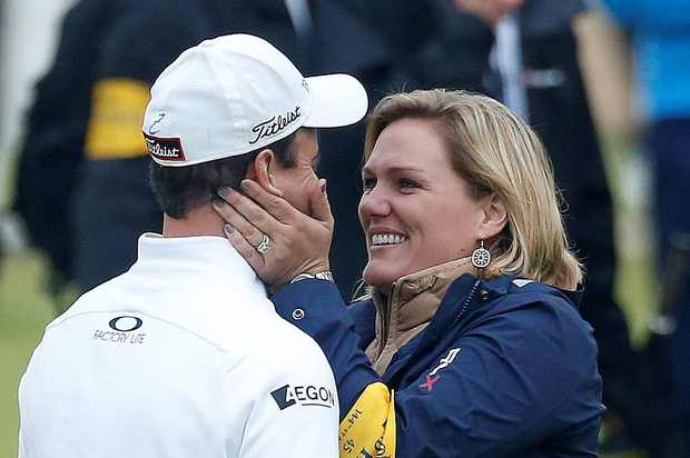 USA's Zach Johnson celebrates winning the Open Championship 2015 with his wife Kim during day five of The Open Championship 2015 at St Andrews, Fife.