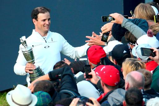Well done: Zach Johnson is congratulated after collecting the Claret Jug