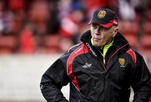 Down senior football manager Jim McCorry survived a county board vote last night over his future as boss of the Mourne county