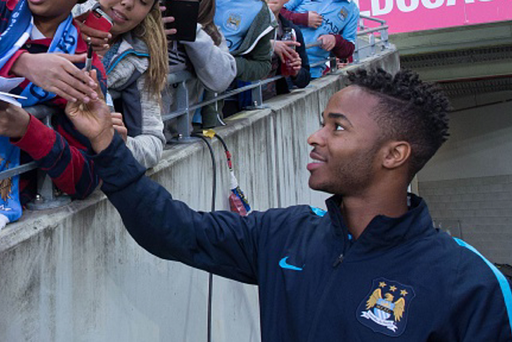 Raheem Sterling of Manchester City greets supporters before the friendly football match.