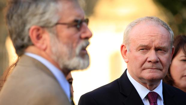 Deputy First Minister of Northern Ireland Martin McGuinness (right) looks at Sinn Fein's President Gerry Adams outside the Palace of Westminster, London, as the party's politicians visited. Photo: Jonathan Brady/PA Wire
