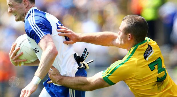 Key moment: Monaghan's Conor McManus gets away from Neil McGee of Donegal in the Ulster final