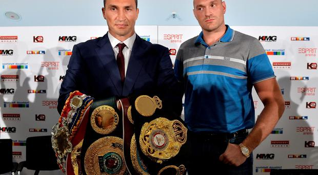 Showdown: Wladimir Klitschko and Tyson Fury yesterday