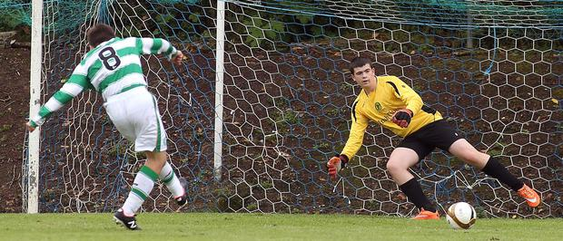Spot on: Celtic's David McKay sends Inishowen 'keeper Jonathan Toye the wrong way from the penalty spot LORCAN DOHERTY/PRESSEYE