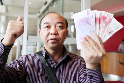 A relieved Bin Zhou with his returned money