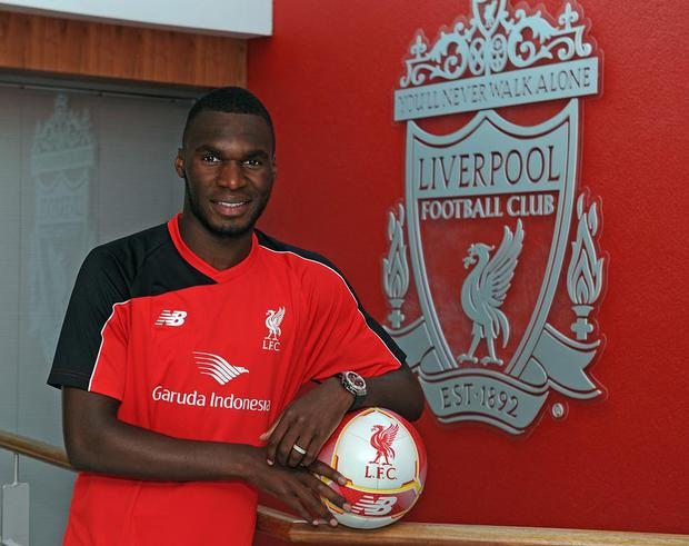 The lean: Christian Benteke will not meet most of his new Liverpool team-mates until they return after Friday's match against a Malaysia XI