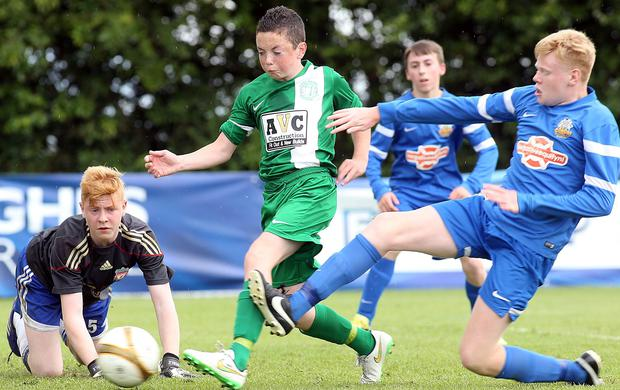 Nervous moment: Foyle Harps' Corey McBride is challenged by Glenavon youngster Jack McIvor LORCAN DOHERTY