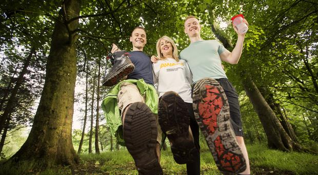 Starting their training early is Cool FM's Paulo Ross, Maria Hammond of Aware and Gary Milligan of Fitness Belfast. Picture by Brian Morrison.