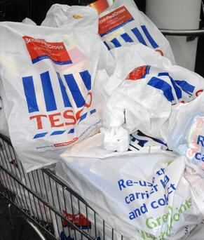The number of plastic bags handed out by Northern Ireland supermarkets has dramatically dropped for the second year