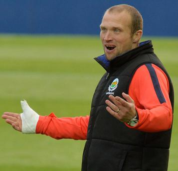 Linfield manager Warren Feeney has signed up to play this season