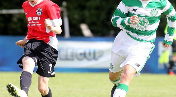 Forward thinking: Bertie Peacock's Jack Shaw takes on Celtic's David McKay in the Foyle Cup
