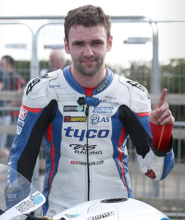 Champion: William Dunlop after winning Supersport race at the Armoy road races last night MATT MACKEY/PRESSEYE
