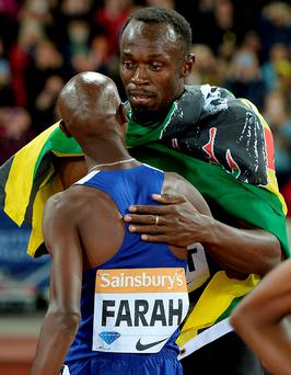 Too quick: Usain Bolt and Mo Farah embrace after both won their respective events
