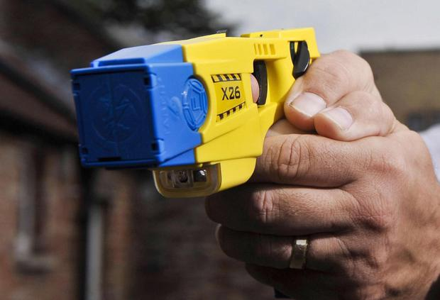 An armed intruder was Tasered by police in Lisburn after he broke into the home of a terrified woman with a young child