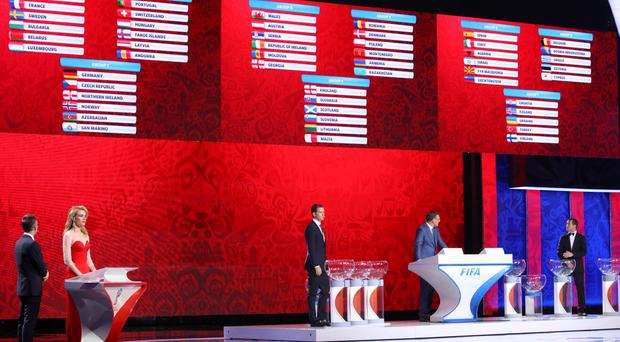 The drawing result for Europe are displayed during the preliminary draw for the 2018 soccer World Cup in Konstantin Palace in St. Petersburg, Russia, Saturday, July 25, 2015. (AP Photo/Dmitry Lovetsky)