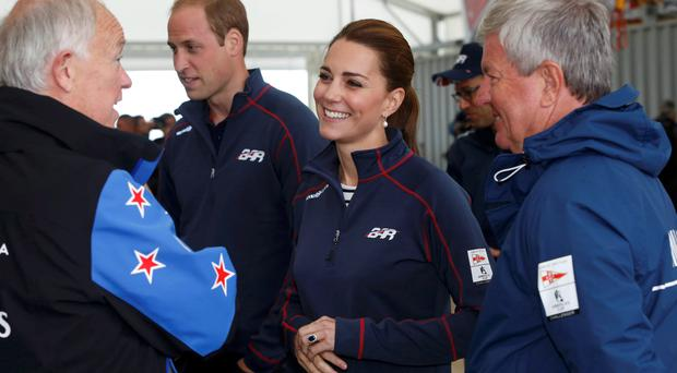 The Duke (second left) and Duchess of Cambridge talks to guests at the team technical area at the Royal Navy Historic Dockyard, Portsmouth, during a visit on the second day of the opening leg of the America's Cup World Series being staged in waters off Portsmouth. Luke MacGregor/PA Wire.