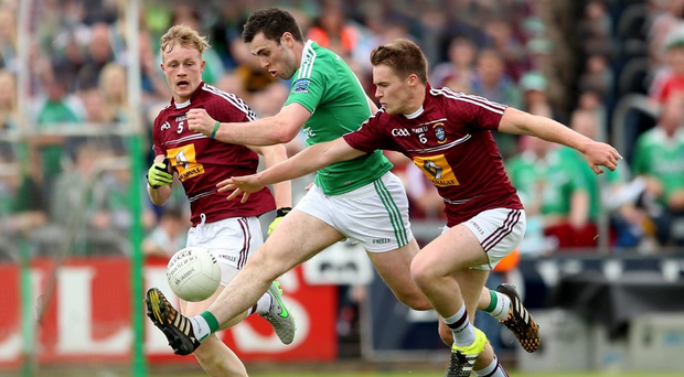 Hard at it: Westmeath's Killian Daly and Paddy Holloway challenge Ryan Jones of Fermanagh