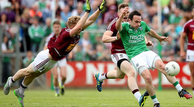Fired up: Westmeath's Killian Daly and Paddy Holloway try to block Ryan Jones from firing off a shot