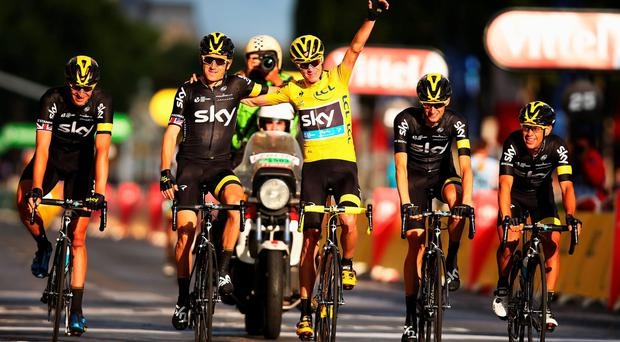 King Chris: Froome celebrates Tour victory with SKY team-mate Geraint Thomas