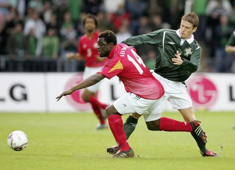 Old foes: Northern Ireland's Steve Davis challenges Gerald Asamoah of Germany in a friendly in 2005
