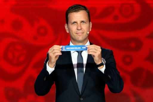Former German striker Oliver Bierhoff shows the name of Northern Ireland during the preliminary draw for the Union of European Football Associations (UEFA) zone for the 2018 World Cup qualifiers at the Konstantin Palace in Saint Petersburg on July 25, 2015. AFP PHOTO / KIRILL KUDRYAVTSEVKIRILL KUDRYAVTSEV/AFP/Getty Images
