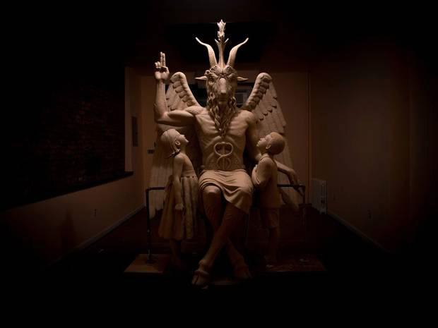 Hundreds gathered at unveiling of one-tonne statue in Detroit, which has sparked protests from Christians. The statue of Baphomet has a goat's head, human body and wings (Facebook/The Satanic Temple - Detroit Chapter)