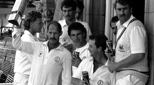 Nottinghamshire captain Clive Rice, surrounded by team mates.