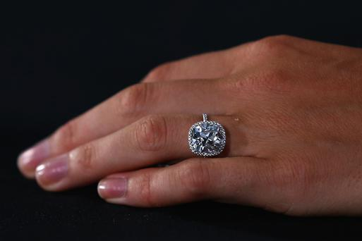 'She ends up with a diamond ring worth £1,000 for £80, and then gets engaged that night,' the court heard (File photo)