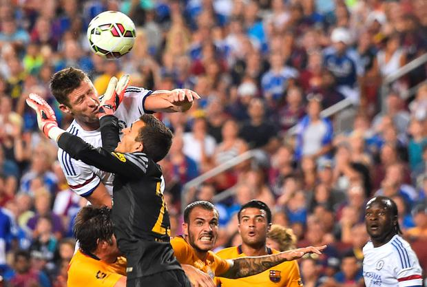 Chelsea's Gary Cahill heads the ball past Barcelona goalkeeper Jordi Masipn to score his team's second goal.