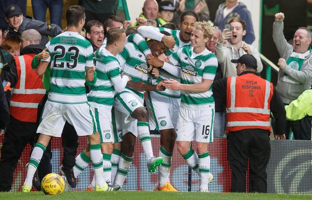 Dedryck Boyata celebrates of Celtic scoring against FK Qarabag during the UEFA Champions League Third Qualifying Round 1st Leg match between Celtic and FK Qarabag at Celtic Park on July 29, 2015 in Glasgow, Scotland. (Photo by Steve Welsh/Getty Images)