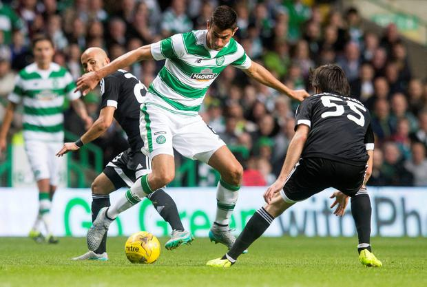 Celtic's Nir Bitton and Qarabag's Badavi Guseynov (right) battle for the ball during the UEFA Champions League third round qualifying match at Celtic Park, Glasgow