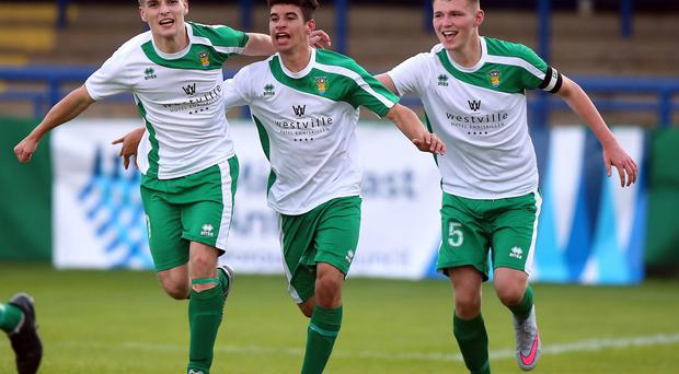 False dawn: Fermanagh's Callum Frempong (centre) celebrates with team-mates after scoring against Malaga but the Spanish boys had the last laugh, winning 2-1 in the Premier Section