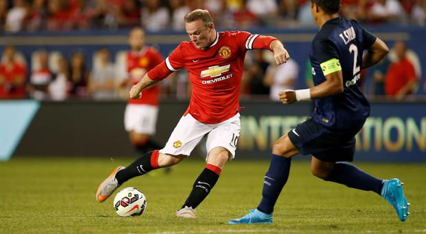 Manchester United forward Wayne Rooney controls the ball against Paris Saint-Germain defender Thiago Emiliano Da Silva during the first half of their International Champions Cup soccer game at Soldier Field on July 29, 2015, in Chicago, Illinois. AFP PHOTO/ JOSHUA LOTTJoshua LOTT/AFP/Getty Images