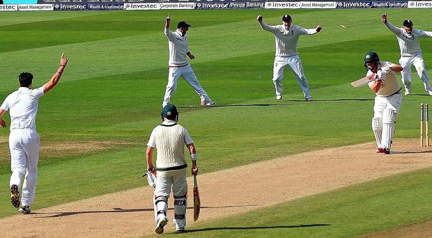 Stumped: England's Steven Finn bowls out Australian ace Mitchell Marsh during the third Ashes Test at Edgbaston