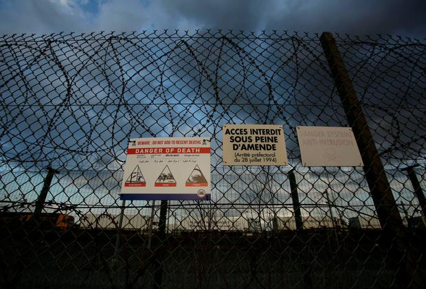 The perimeter fence of the Eurotunnel site at Coquelles in Calais, France. Photo: Yui Mok/PA Wire