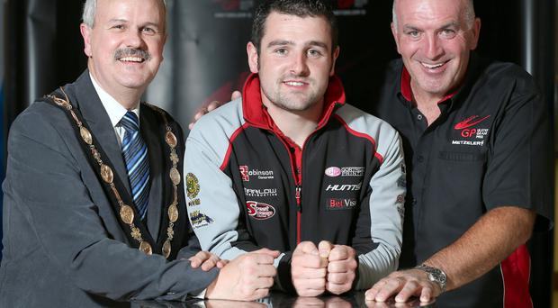 Revved up: Michael Dunlop is confident he can end his season on a high at next week's Metzeler Ulster Grand Prix. He is pictured with Cllr Thomas Beckett, Mayor of Lisburn and Castlereagh City Council and Noel Johnston, Clerk of the Course