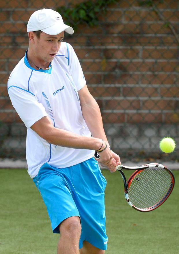 Trophy delight: Sam Bothwell won the boys' doubles final