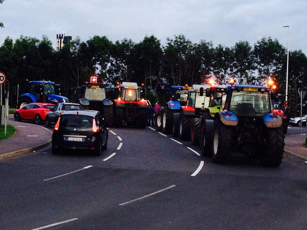 Dairy farmers block the entrance to Asda in Coleraine Pic: Alastair Rainey