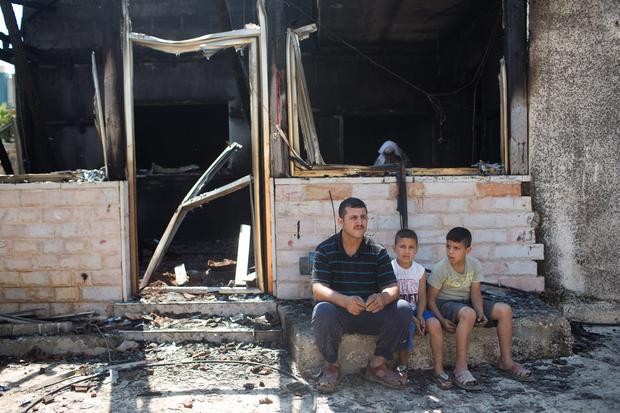 Family members and relatives of 18 month old baby, Ali Saad-Dawabsheh, view the remains of their house after the fire (Photo by Oren Ziv/Getty Images) (Photo by Oren Ziv/Getty Images)