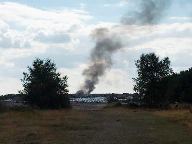 Taken with permission from the Twitter feed@NathanGFilm of smoke rising from Blackbushe airport after a light aircraft crashed into a car auction shortly after take-off