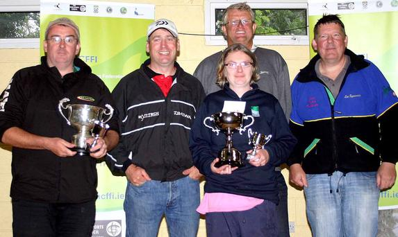 Catch of the day: Fergal Smith (left) and Mary Tigwell receive their NCFFI All-Ireland Championship trophies at Killeshandra, Co Cavan