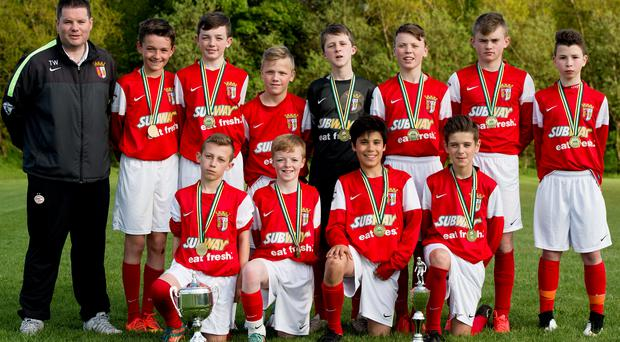 Prize guys: Tim Wareing and his TW Braga side with the Lisburn U13 League title MARK MARLOW