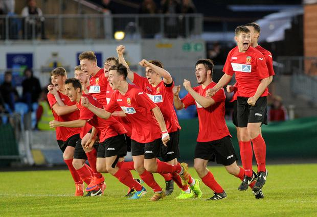 The County Antrim players celebrate after winning the Milk Cup at Ballymena Showgrounds last night