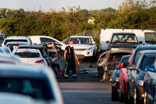 Emergency services at Blackbushe Airport in Hampshire, after four people died when a private Phenom 300 jet crash-landed. Photo: Daniel Leal-Olivas/PA