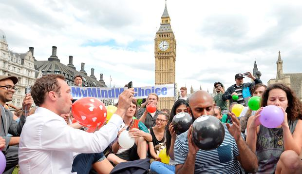 Demonstrators protesting against Government drug policy stage a mass inhalation of so-called