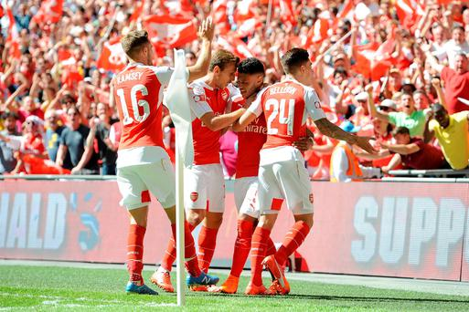 Arsenal's Alex Oxlade-Chamberlain (centre right) celebrates scoring their first goal of the game with team-mates during the FA Community Shield at Wembley Stadium, London. Andrew Matthews/PA Wire.
