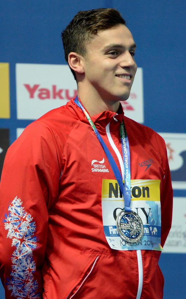 James Guy on the podium after winning a silver in the men's 400m freestyle swimming event at the 2015 FINA World Championships