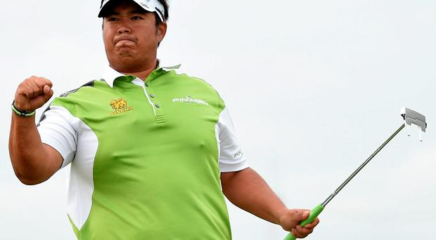 Kiradech Aphibarnrat celebrates winning his match against Sweden's Robert Karlsson